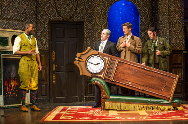 3 actors carrying a grandfather clock