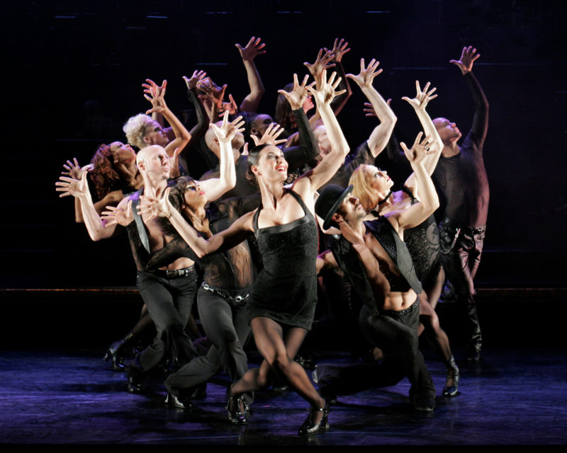 "The actress playing Velma Kelly and the ensemble are raising jazz hands during the number ""All That Jazz"" from Broadway's CHICAGO."
